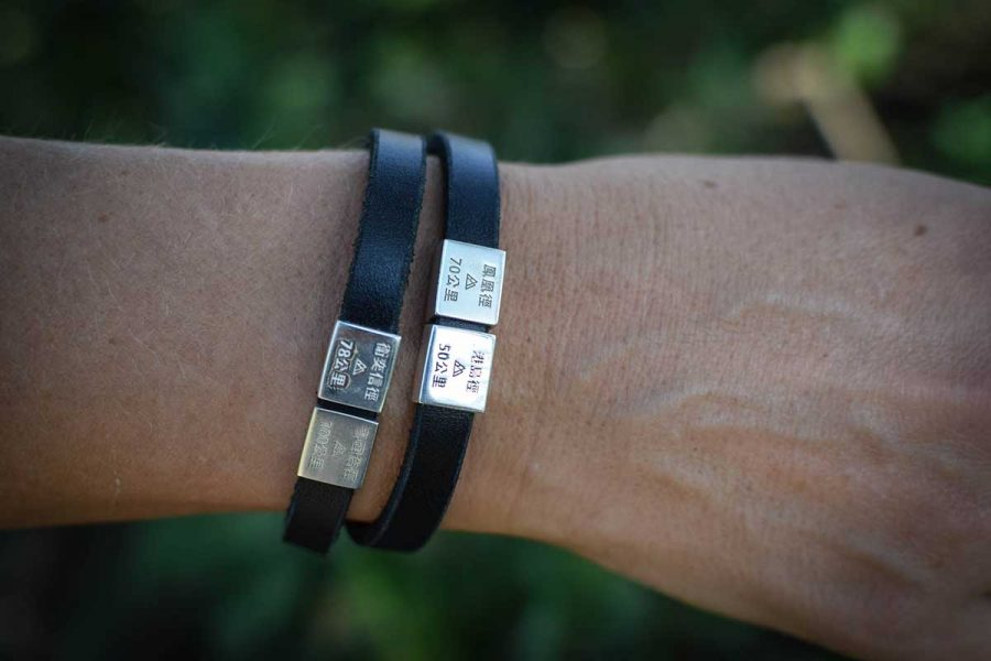 A black stylish leather strap for double strap. Can be made as a single loop strap as well. For every big trail you have finished you can order a new charm. Have you done all four already, well then just order the whole bracelet with all the charms. Every charm is made in silver and plated with white gold. The trail name and length are engraved in both English and Chinese.