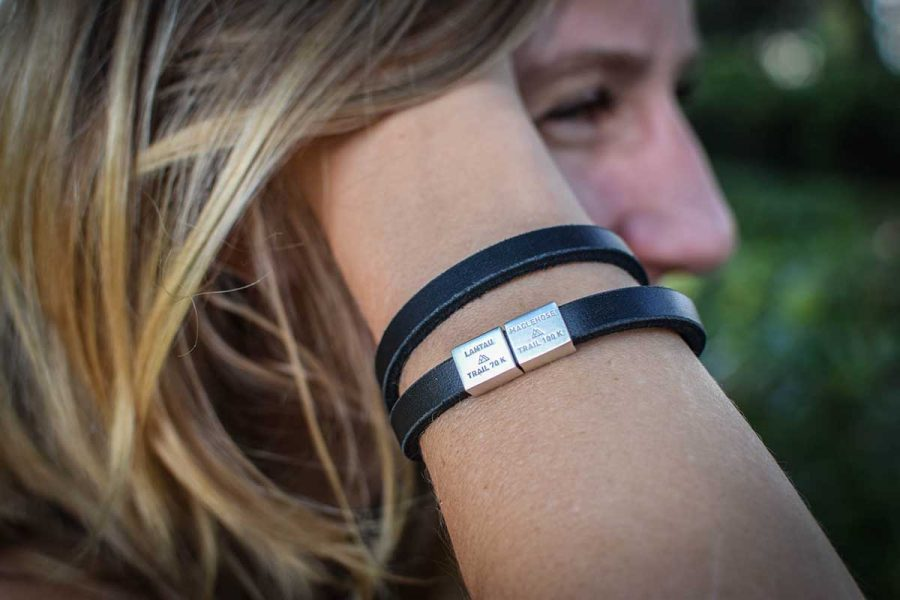 A black stylish leather strap for double strap. Can be made as a single loop strap as well. For every big trail you have finished you can order a new charm. Have you done all four already, well then just order the whole bracelet with all the charms. Every charm is made in silver and plated with white gold. The trail name and length are engraved in both English and Chinese. hiking bracelet with charms hong kong